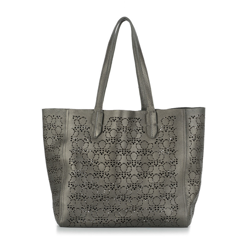 Complete your holiday look with the Pattern Signature Leather Bag