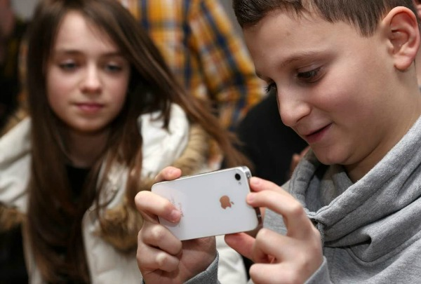 5 tips to help your teen get out of his virtual world berlin germany february 11 a student uses an apple iphone smartphone at the sciox Image collections