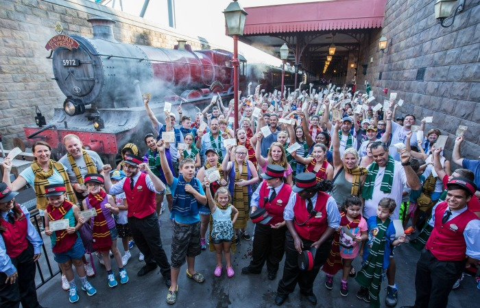 Cheers from guests filled the air at Hogsmeade Station today as Universal Orlando Resort celebrated its one millionth rider on the Hogwarts Express – the iconic train that transported Harry Potter and his friends between Hogsmeade Station and King's Cross Station in J.K. Rowling's beloved series. To celebrate this magical milestone, nearly two hundred guests were given complimentary Butterbeer ice-cream. In early July, guests began boarding the Hogwarts Express to travel between The Wizarding World of Harry Potter – Hogsmeade in Universal's Islands of Adventure and The Wizarding World of Harry Potter – Diagon Alley in Universal Studios Florida. The incredible journey, which requires a park-to-park ticket, combines powerful storytelling, live special effects, lifelike animation and state-of-the-art technology to take riders on the journey of a lifetime. © 2014 Universal Orlando Resort. All rights reserved. HARRY POTTER, characters, names and related indicia are trademarks of and © Warner Bros. Entertainment Inc. Harry Potter Publishing Rights © JKR.  (s14)
