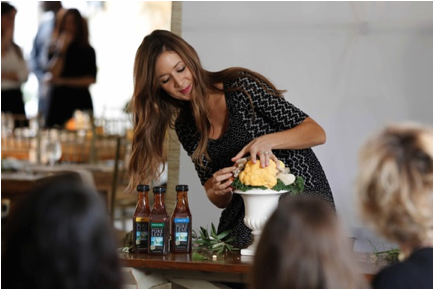 """Camille Styles, author of new book """"Camille Styles Entertaining: Inspired Gatherings and Effortless Style"""" shows attendees how to create a simple and beautiful centerpiece from fresh produce at Pure Leaf Iced Tea's Fall Luncheon at the New York Botanical Garden."""