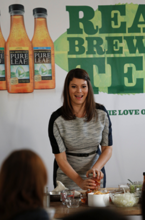 Top Chef's Gail Simmons shows attendees how to pickle radishes with tea at Pure Leaf Iced Tea's Fall Luncheon at the New York Botanical Garden.